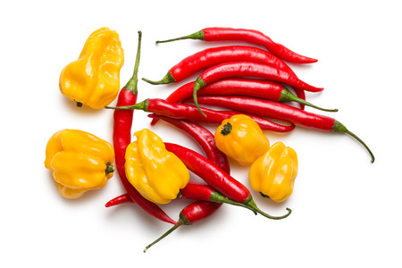 habanero: top view of red chili peppers and yellow habanero on white background Stock Photo