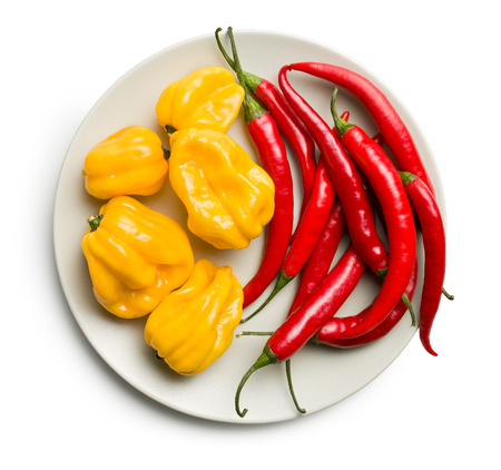 habanero: top view of chili peppers and habanero on plate on white background Stock Photo