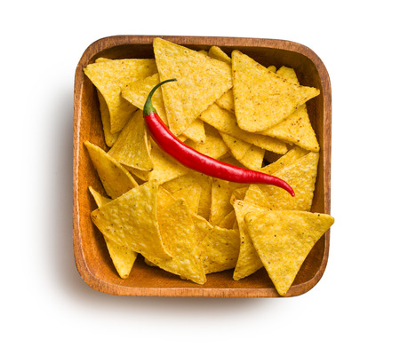 corn chip: top view of tortilla chips with red chili pepper in wooden bowl on white background