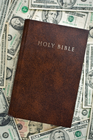 top view of holy bible on us dollars