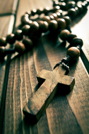 rosary beads on wooden table photo