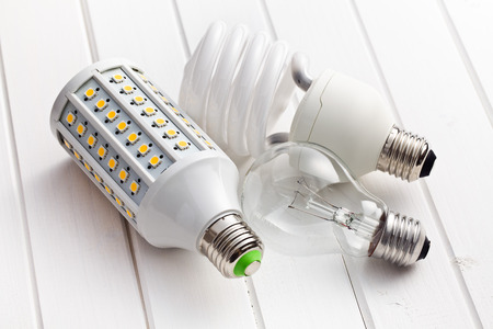 low light: various lighting bulbs on wooden background