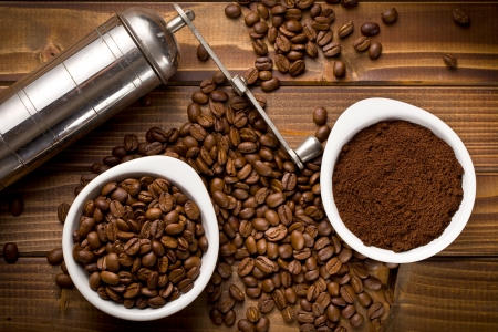 grinded: top view of coffee beans with ground coffee and grinder Stock Photo