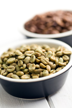unroasted: unroasted green coffee beans in ceramic bowl