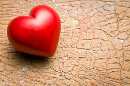 heart of stone: red stone heart on old cracked background