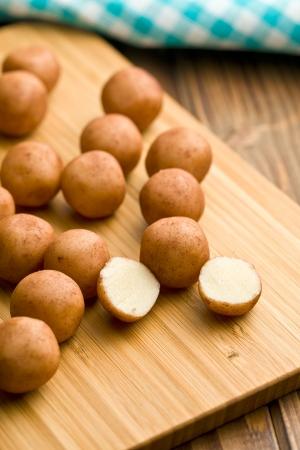 marzipan: marzipan balls on chopping boards Stock Photo