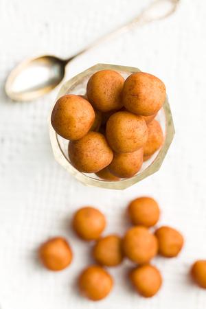 marzipan: the marzipan balls in the tea glass Stock Photo