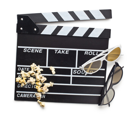 top view of clapperboard with 3d glasses and popcorn on white background photo