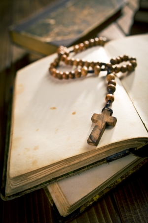 open diary: open old book with rosary beads