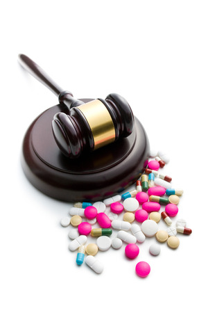judge s gavel with pills