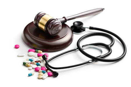 judge s gavel with stethoscope and pills Stock Photo