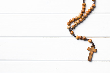 rosary beads: Wooden rosary beads on white wooden table Stock Photo