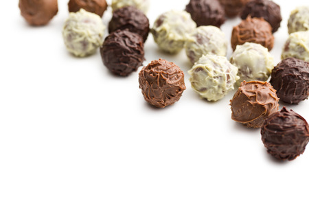 praline: mix of chocolate trufles on white background
