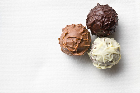 top view of chocolate truffles on white tablecloth