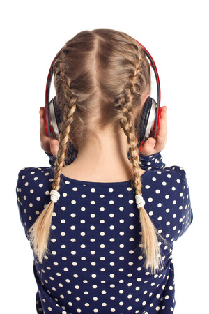pigtails: little girl with headphones from behind
