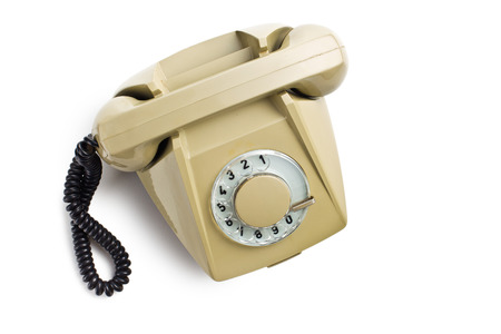 antique phone: top view of old beige telephone on white background