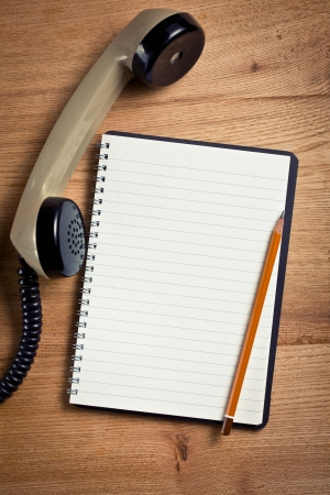 top view of old telephone handset with notebook Stock Photo - 25172059