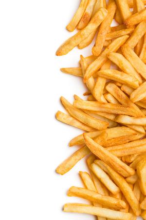 papas fritas: vista desde arriba de las patatas fritas en el fondo blanco Foto de archivo