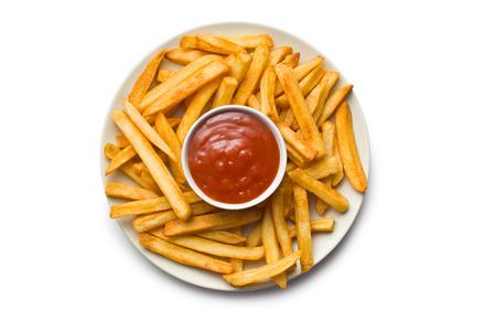 bovenaanzicht van frieten met ketchup op plaat
