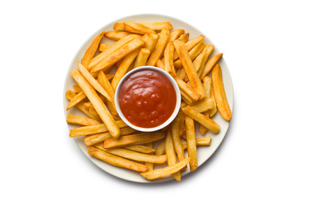 top view of french fries with ketchup on plate photo