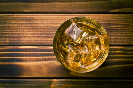 whiskey glass: top view of whiskey in glass with ice Stock Photo