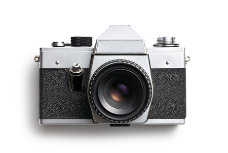 top view of old camera on white background photo