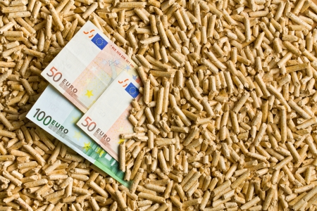 money to burn: top view of pellets with euro bills Stock Photo