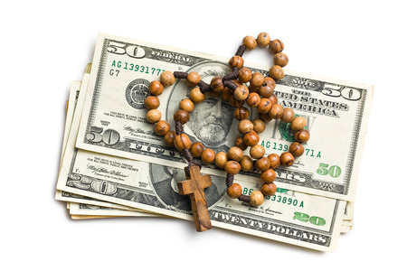 rosary with american dollars on white background photo