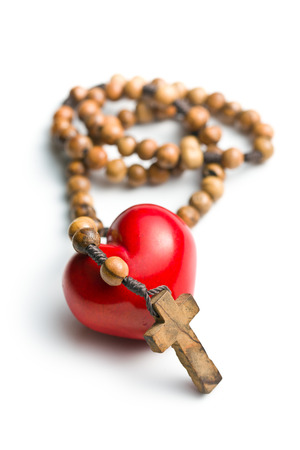 heart of stone: rosary with heart of stone on white background