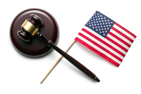 top view of judge gavel with american flag photo