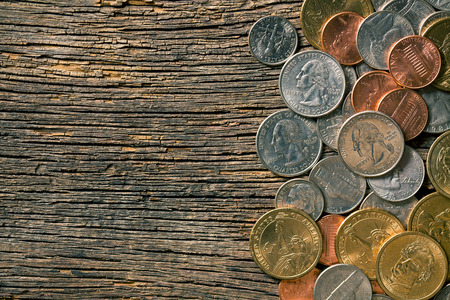numismatics: the U.S. coins on old wooden background