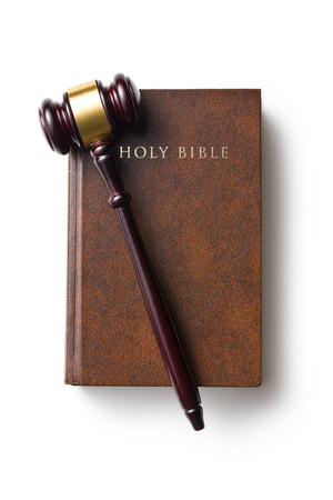 top view of judge gavel on holy bible on white background Stock Photo
