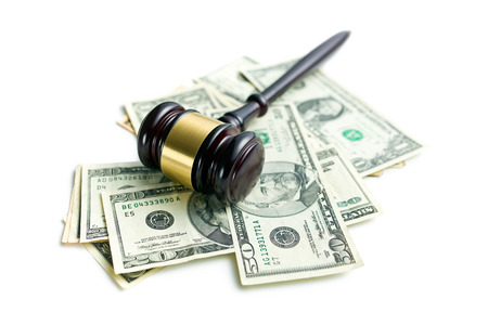 judge gavel on american dollars on white background Stock Photo