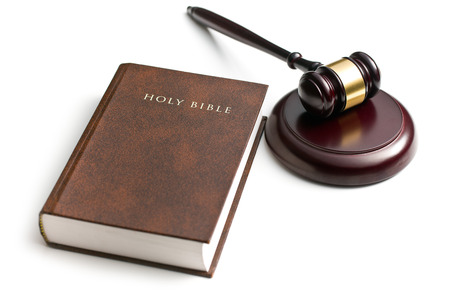 judge gavel with holy bible on white background photo