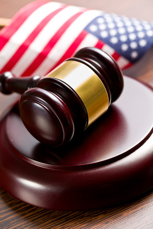 judge gavel with american flag on wooden background photo