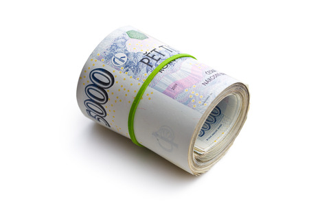 the roll of czech money on white background photo