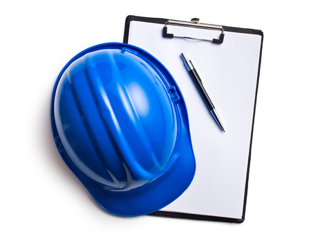 hard hat with clipboard on white background Stock Photo