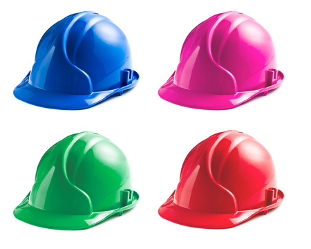 various colors of hard hats on white background Stock Photo