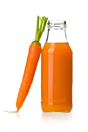 the bottle of carrot juice with carrot photo