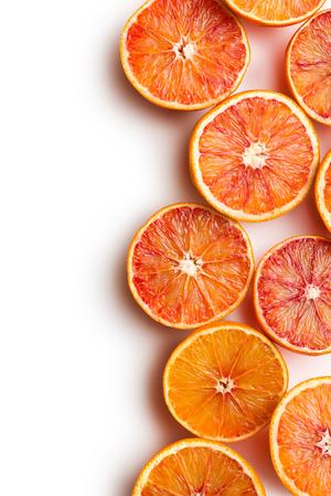 orange peel:  red oranges on white background