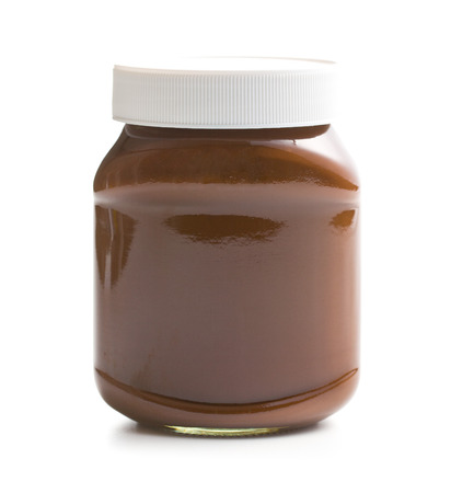 chocolate spread in jar on white background Stock Photo