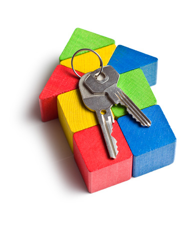 play blocks: the house made from wooden toy blocks with keys Stock Photo