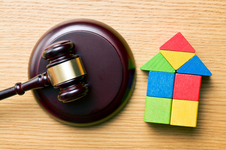 hypothec: the wooden house and judge gavel on wooden table Stock Photo