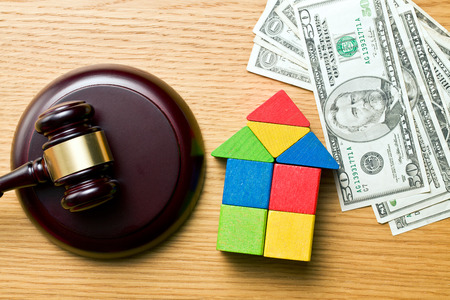 the wooden house with money and judge gavel Stock Photo - 27331750