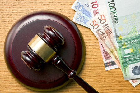 judge gavel and euro currency on wooden table photo