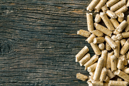 the wooden pellets on old wooden background photo