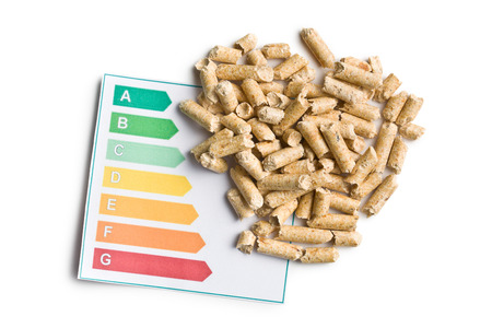 wooden pellets and energy efficiency levels on white background photo