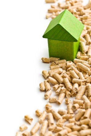 wood pellet:  The concept of ecological and economic heating. Wooden pellets. Stock Photo