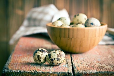the quail eggs on old wooden table