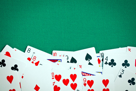 poker cards on green casino table photo